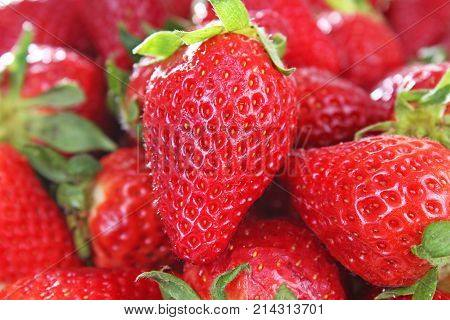 Strawberry background. Red whole strawberry as pattern texture. Strawberries. Sweet
