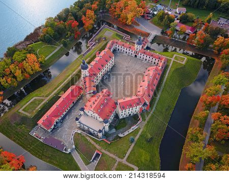 Nesvizh Castle Belarus Europe. Aerial view of famous belarusian medieval castle. Historic building in autumn. Symbol of belorussian architecture. Cityscape of Nesvizh. Birds eye panorama