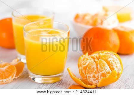 Tangerines peeled tangerines and tangerine juice in glass. Mandarine juice.