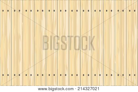 A pine fence made of brightly stained softwood planks showing the wood grain.