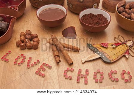 It is image of hot chocolate drink and ingredients on it