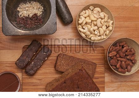 It is image of healthy sticks with cocoa beans and cashews