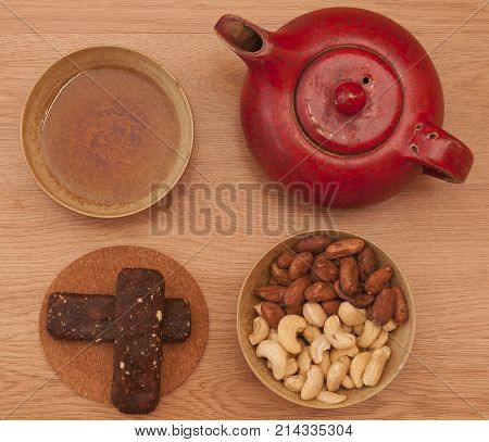 It is image of healthy stick with cocoa beans and cashew