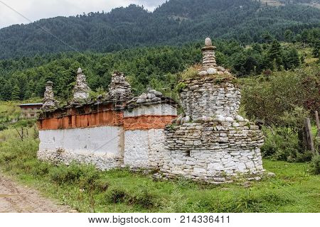 Chorten made of red and white colored stones in a garden in Bumthang Bhutan Asia