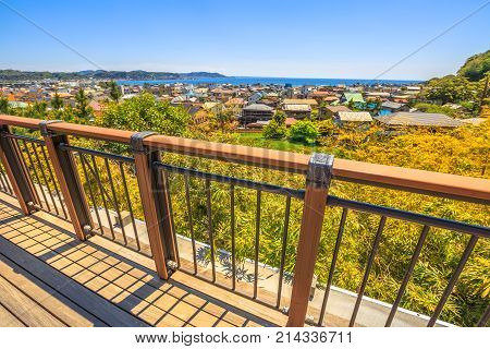Spectacular aerial view of Kamakura Sagami Bay from observation platform in Hase-dera temple or Hase-kannon in Kamakura, Japan. Beautiful sunny day with blue sky. Kamakura skyline.
