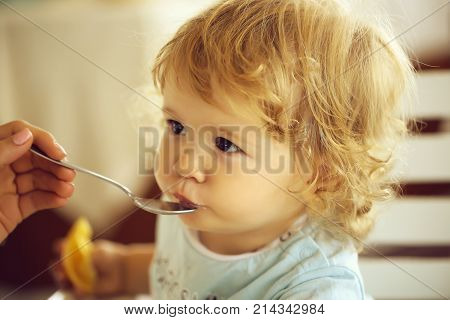 Baby Boy Fed With Spoon