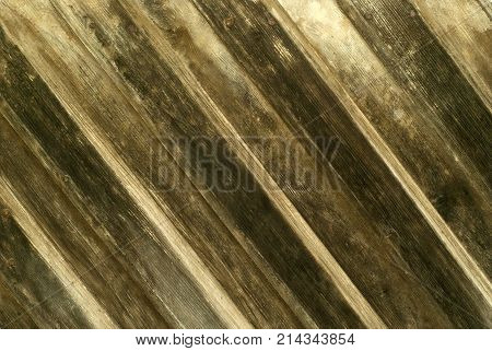 background texture: wall of diagonal overlapping planks darkened from the time