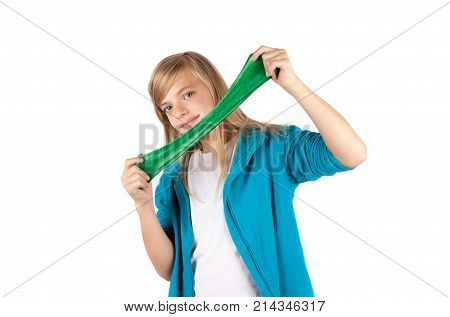 Girl playing with green slime. Isolated on white background.