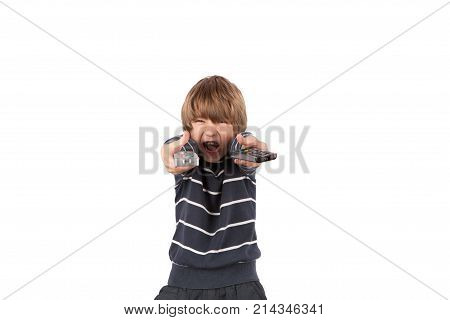 Cheerful boy posing with two TV remote controls. Isolated on white background