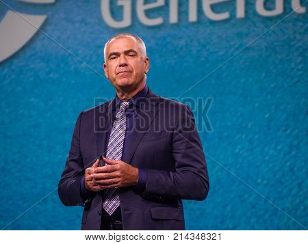 BERLIN GERMANY - NOV 13 2017: NetApp vice president of Worldwide Field and Customer Operations Henri Richard makes speech at NetApp Insight 2017 conference in Berlin Germany on Nov 13 2017.