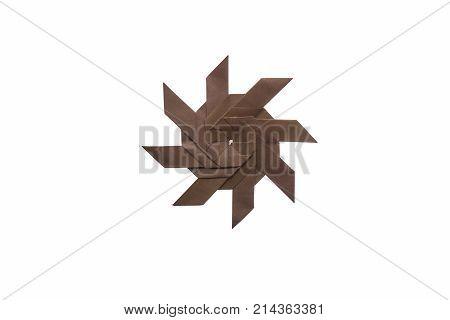 Shuriken origami model isolated on white background. Concept of Japanese metal multi-dagger weapon.