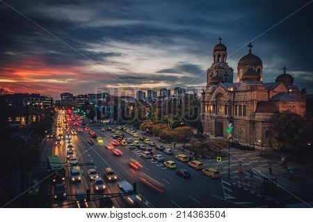 Colorful sunset over The Cathedral of the Assumption in Varna aerial view