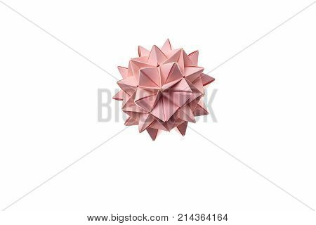 Pink spiky ball origami, isolated on white. Amazing craft made by talented kid. Kusudama ball that looks like a flower.