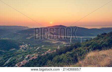 Long highway viaduct at sunset. Crni Kal, Slovenia