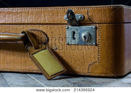 Old Stylish Suitcase. Lock With The Key In The Bag. Suitcase On A Wooden Table.