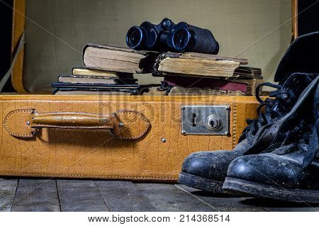 Old Stylish Suitcase. Old Books In A Suitcase. Suitcase On A Wooden Table.