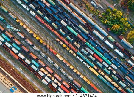 Top View Of Colorful Cargo Trains. Aerial View