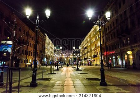 ST. PETERSBURG, RUSSIA - DECEMBER 25, 2016: Night cityscape, street decoration to New Year and Christmas and street lights on Malaya Konyushennaya Street. Winter holidays in St. Petersburg, Russia.