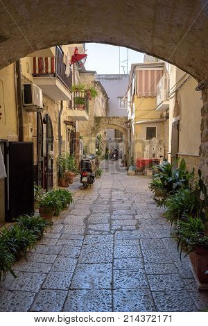 gate to the backyard in the old town of Bari Apulia Italy