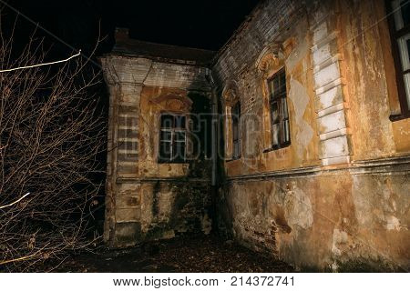 Old creepy abandoned haunted mansion at night, eerie house, horror atmosphere