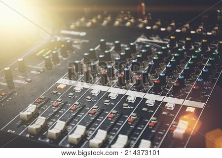 Professional sound mixer in studio for music and sound recording equipment, light effect, toned