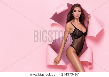 Sexy Brunette Girl Posing In Lingerie On Pink Background.