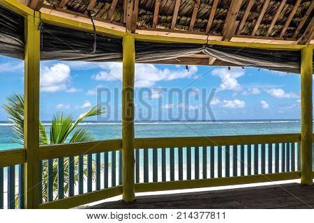 Lalomanu Beach Upolu Island Samoa - October 27 2017: View from inside a traditional waterfront beach fale hut onto the blue Pacific Ocean.