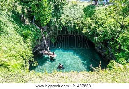 To Sua Trench Upolu Island Samoa - October 27 2017: also known as the Te Sua or Tosua Trench this swimming hole is a popular Samoan tourist attraction