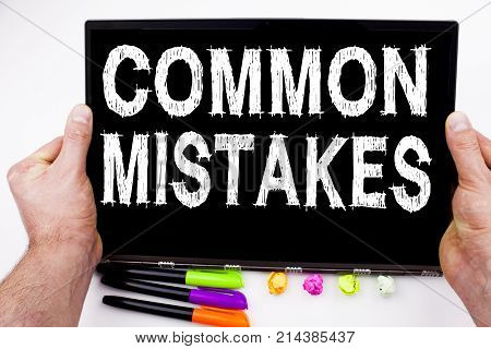 Common Mistakes Text Written On Tablet, Computer In The Office With Marker, Pen, Stationery. Busines