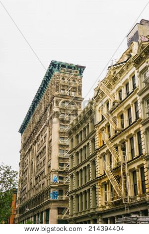 New York City, United States of America - May 02, 2016: The old residential buildings with fire escape stairs in Soho, New York City