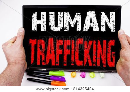 Human Trafficking Text Written On Tablet, Computer In The Office With Marker, Pen, Stationery. Busin
