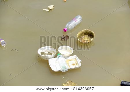 Non-biodegradable waste in water. Save environment concept.