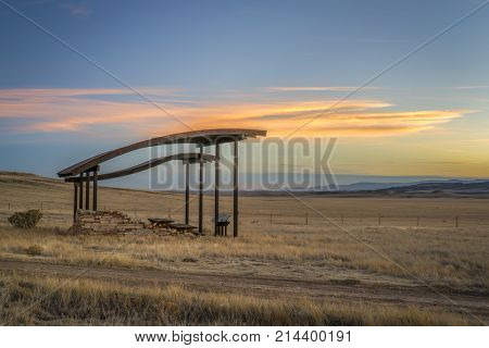 picnic shelter and trailhead at foothills in northern Colorado near Fort Collins - Soapstone Prairie Natural Area in late fall scenery