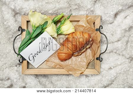 Tray with tasty croissant,