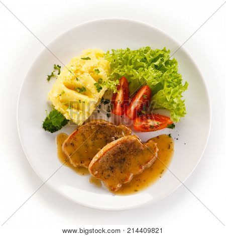 Fried pork chop, puree and vegetables