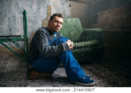 Depressed man sitting on the floor, psycho patient