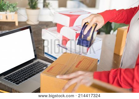 Startup Small Business Owner Packing Cardboard Box At Workplace. Woman Entrepreneur Seller Prepare P