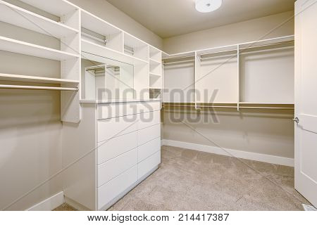White Walk-in Closet With Shelves, Drawers And Clothes Rails