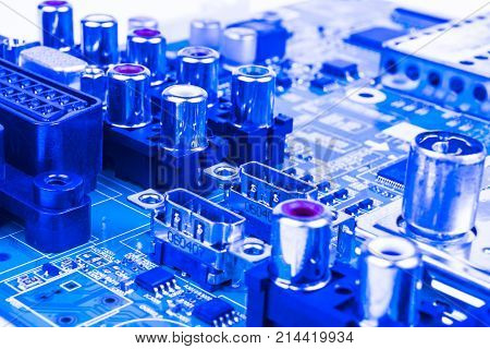 Circuitboard with resistors microchips and electronic components. Electronic computer hardware technology. Integrated communication processor. Information engineering component. Semiconductor. PCB. Blue tones