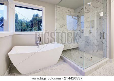 Sleek Bathroom Features Freestanding Bathtub