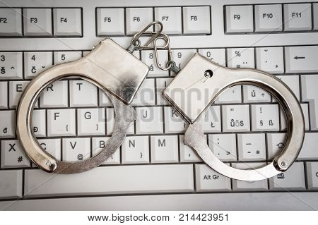 Top View Of Keyboard And Handcuffs - Cyber Crime Concept