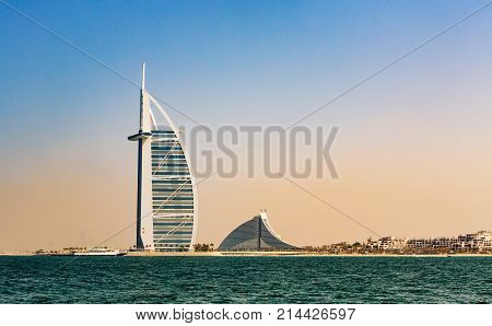 DUBAI UAE - NOVEMBER 7 2016: Burj Al Arab hotel on Jumeirah beach in Dubai. Modern architecture luxury beach resort summer vacation and tourism concept. View from boat. Al Arab. Dubai.