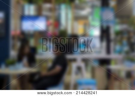 people in expo exhibition hall public event business trade show. defocused blur image for abstract background