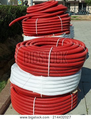 The roll of red Flexible Plastic Pipes