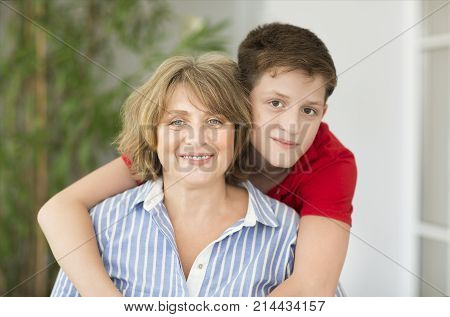 Mid-age woman with teen boy. Happy family concept