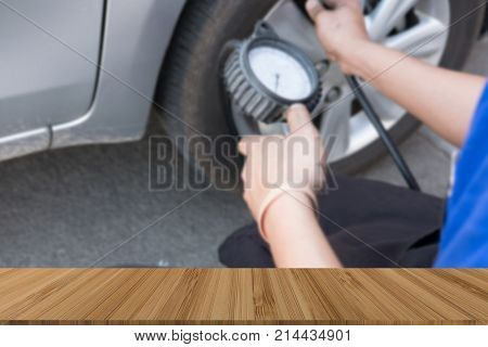 Tire Inflator. Mechanic Holding Gauge For Car Tyre Pressure Measurement. Hand Inflating Auto Wheel W
