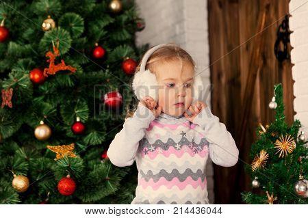 Pretty Little Child Near Christmas Tree.