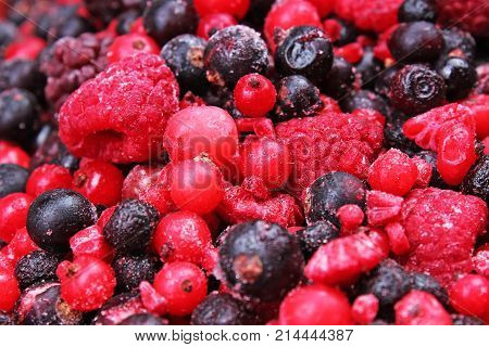 Frozen mixed berries berry as background. Blueberries, raspberries black berries and currant mulberry texture pattern
