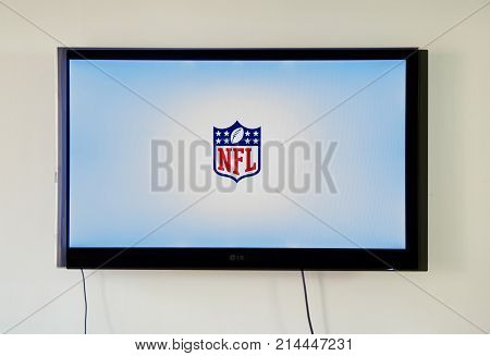 MONTREAL CANADA - NOVEMBER 15 2017: NFL app and logo TV on LG TV screen. The National Football League is a professional American football league consisting of 32 teams