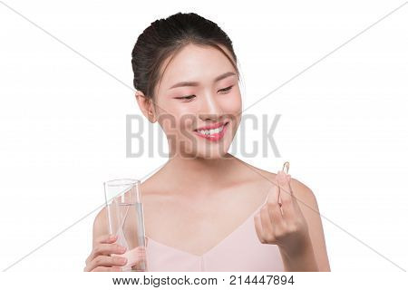 Smiling Asian Woman  Eating Pills And Drinking Water